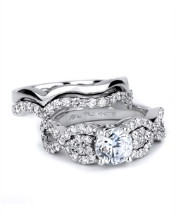 Be dazzled with this engagement ring sparkling 0.86tcw of round diamonds. Shown here  with matching wedding band designed by TRUE KNOTS&#174; for the TRUE WOMAN&#174; Engagement Ring Collection. Available in platinum and gold.