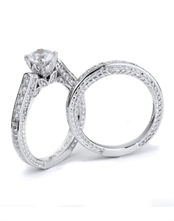 Let your inner beauty shine with this eleganly crafted engagement ring set designed by TRUE KNOTS® for the TRUE WOMAN® Engagement Ring Collection. This vintage inspired design boasts 0.57tcw in round diamonds and is available in platinum and gold.