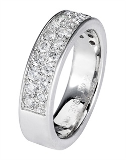 Steeped in tradition and designed to emanate the warmth, the sparkle and the light of diamonds in a pave set bridal jewelry collection. Featured is a 14K white gold eternity band sparkling with 0.90tcw of  round diamonds. All from the Love is Light collection. Available in platinum and gold.