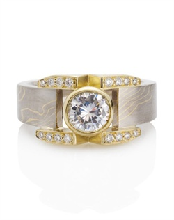 18k yellow gold, 14k palladium white gold, 1.25 TCW white diamond, Center stone is 1 CT
