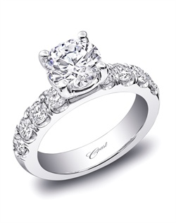 An impressive and elegant engagement ring featuring round brilliant diamonds on the shoulders of the ring, and a custom 4 prong head. Total diamond weight .93CT, not including center stone. Created for a 1.5CT center stone in white gold or platinum.