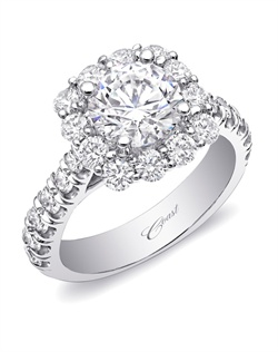 A glamorous engagement ring featuring round diamonds on the shoulders of the ring, crowned by a show-stopping cushion shaped diamond halo. Total diamond weight 1.4CT, not including center stone. Created for a 1.5CT center stone.