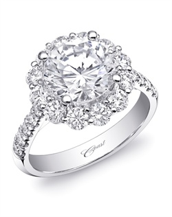 This stunning Charisma engagement ring features a sumptuous round diamond halo, as well as diamonds down the shoulders of the ring. Total diamond weight 1.22CT, not including center stone. Created for a 2CT center stone in white gold or platinum.
