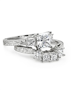 Hand engraved platinum engagement ring made for a 1CT princess cut center stone, featuring princess cut side diamonds with a total weight of .37CT (not including center stone). Matching band features princess cut diamonds totaling .60CT.