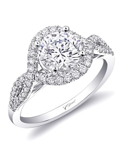 Strings of diamonds flatter the finger, as they intertwine to create a show-stopping halo. Total diamond weight .26CT, not including center stone. Created for a 1.5CT center stone in white gold or platinum.