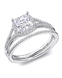 Delicate diamond bands arch up the shoulders of this engagement ring, framing a gorgeous princess cut center stone. Total diamond weight .19CT, not including center stone. Created for a 5.5mm princess cut center stone in white gold or platinum. A petite matching diamond band completes the look. Total diamond weight in band: .07CT.