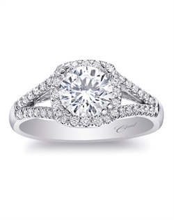 A modern halo design with a diamond-encrusted split shank make this ring an all-time favorite. Total weight .24CT, not including center stone. Created for a 1CT center stone in white gold or platinum.