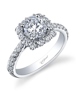A generous cushion-shaped halo of round diamonds makes this engagement ring a sparkling symbol of true love. Diamonds cascade down the shoulders of the shank, adding to the impact of this radiant ring. Total diamond weight .78CT, not including center stone. Created for a 1CT center stone in white gold or platinum.