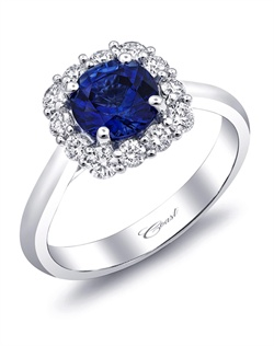 From the Coast Signature Color Collection, this ring features a gorgeous 1.08CT sapphire gemstone surrounded by a cushion-shaped halo of round diamonds. Total Diamond weight: .47CT.