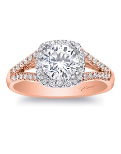 A modern halo design with a diamond-encrusted split shank make this ring an all-time favorite. Total weight .24CT, not including center stone. Created for a 1CT center stone in rose and white gold.
