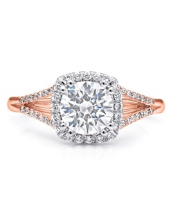 This beautifully refined split shank halo engagement ring from the Charisma Collection features petite round brilliant diamonds. Total diamond weight .17CT, not including center stone. Created for a 1CT center stone in rose and white gold.