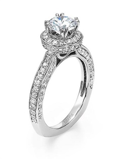 Diamond solitaire engagement ring with surprise stones and side diamond detailing on band