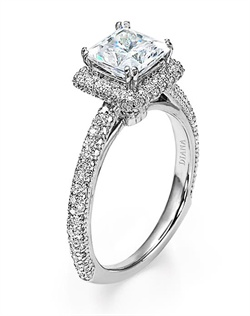 Diamond engagement ring with princess cut center stone surrounded by pave diamonds