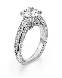 Diamond engagement ring with round center stone, burnished diamond band and pave diamond floral side treatment