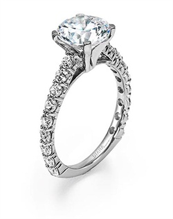 Diamond engagement ring with round center stone and diamond enhanced band