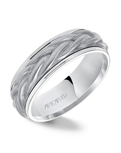 7.0mm wedding band consisting of a rope center motif and flat bright rims.