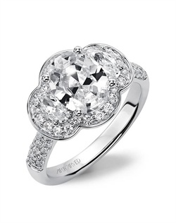 Three stone oval cut diamond engagement ring with diamond enhanced halo and band.