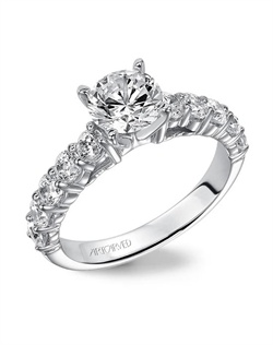 Diamond engagement ring with round center stone and round side stones in the band.