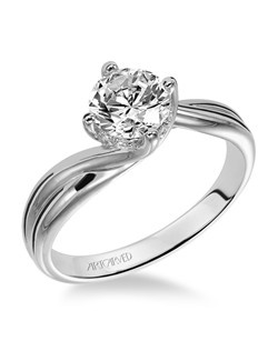 Diamond solitaire engagement ring with round center stone set in a twist setting.