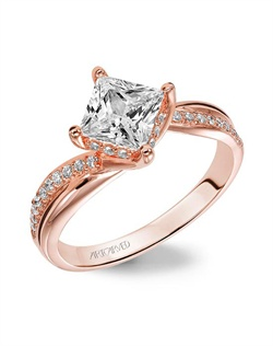 Diamond engagement ring with princess cut center stone set in a Rose Gold twist setting and a diamond enhanced band.