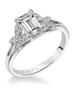 Diamond engagement ring with emerald cut center stone and diamond enhanced band.
