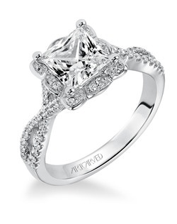 Diamond engagement ring with halo and open twist diamond band.