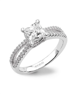 Diamond engagement ring with diamond petite prong double row band.
