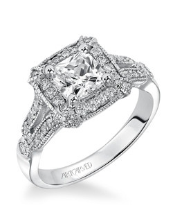 Diamond engagement ring featuring a diamond halo, claw prongs and open shank design with milgrain.