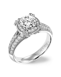 Diamond engagement ring featuring a diamond halo, claw prongs and diamond enhanced band with milgrain.