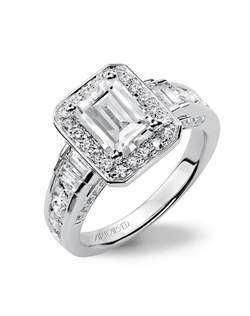 Emerald cut engagement ring featuring a diamond halo and channel set diamond band.