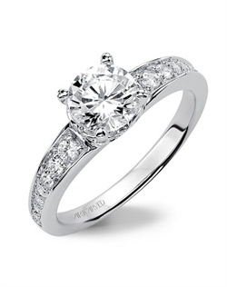 Diamond engagement ring featuring a diamond enhanced gallery and band.