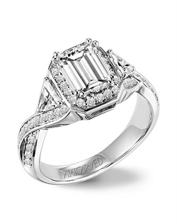 Emerald cut diamond engagement ring featuring a halo accentuated by trillion side diamonds and a split shank diamond band