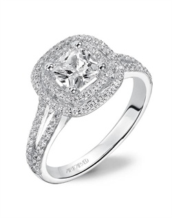 Cushion cut engagement ring with double diamond halo and split diamond band.
