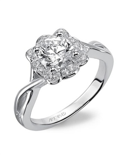 Diamond engagement ring with diamond halo and twisted polished band.