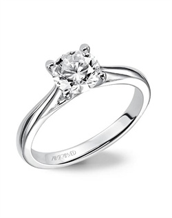 Solitaire engagement ring with polished band.