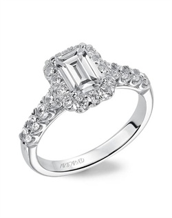 Emerald cut diamond halo engagement ring with diamond band.