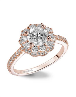 Halo engagement ring with diamond shank.