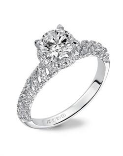 Diamond Halo engagement ring with unique prong set diamonds and bezel set surprise stones under the center stone.