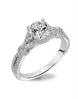 Diamond engagement ring with prong set diamond shank and filigree design.