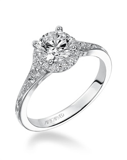 Diamond Halo  engagement ring with graduated prong set diamonds. This ring is  enhanced with a beautiful engraved design on the shank