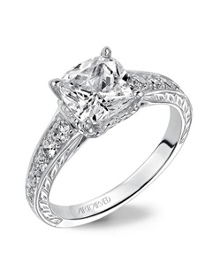 Diamond  engagement ring with graduated prong set diamonds. This ring is  enhanced with a beautiful engraved design on the shank