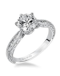 Six prong diamond  engagement ring featuring  engraved shank and delicate design under center stone.