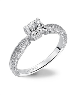 Diamond   engagement ring featuring   diamond/engraved shank and milgrain borders.