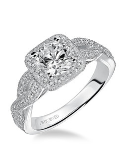 Diamond Halo engagement ring with milgrain detail on halo and open twist shank.