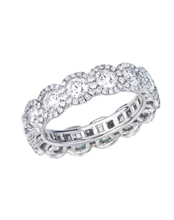 This ring is set with 14 Forevermark diamonds with pave around each stone. Available as a 5 or 7 stone band.