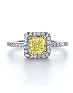This rare exotic Fancy Yellow Forevermark diamond is elegantly crafted in 18K white gold surrounded by a halo of white diamonds. Ring is available in a range of sizes and qualities.