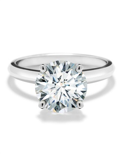 This solitaire engagement ring is set in 18K white gold and features a beautiful round Forevermark diamond. Rings are available in a range of sizes, qualities and metals.