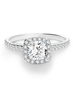 This Cushion Halo Ring is set in 18K white gold and features a Forevermark diamond. Rings are available in a range of sizes, qualities and metals.