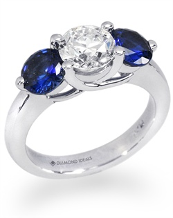 This customized three stone trellis ring features 2 stunning 3/4 sapphires (5.5mm) flanking a 1 carat round diamond (not ncluded in quoted price). All rings can be order in any metal.
