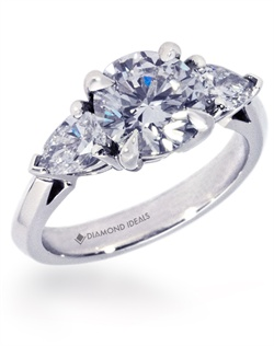 This custom engagement ring features a 1.75ct round center stone (not ncluded in quoted price) with 1.2ctTW pear-shape diamonds on the side. This is a basket head with an airline or cathedral set-up and a slightly rounded knife edge shank. All rings can be order in any metal.